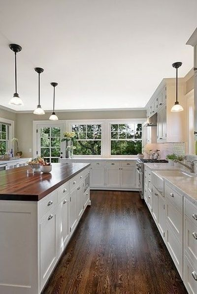 kitchen with dark wood floors and light cabinets - wood floors