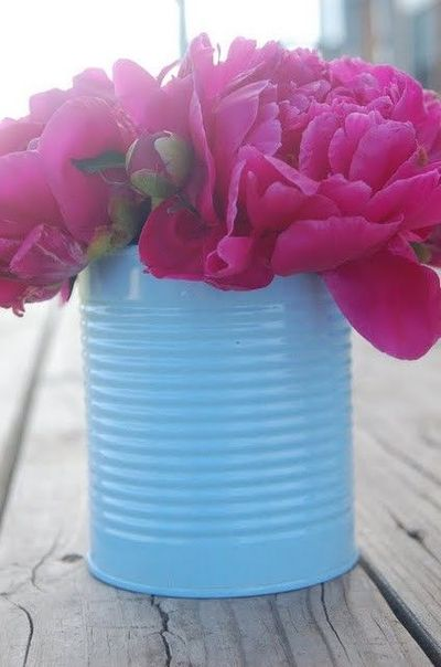 such a simple idea but could be a great table decoration at a shower or party - spraypainted tin cans in a color to match your party decor