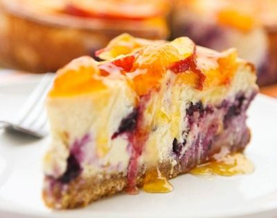 Peach-topped blueberry cheesecake
