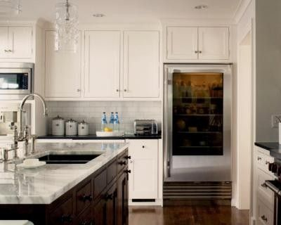 Light cabinets dark island and alternating light dark counte for