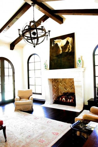 Beautifully Designed Arched Windows Dark Trim White Walls And Orb Chandelier