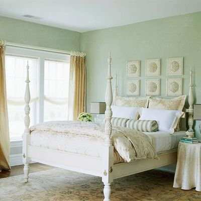 sand colored curtains and bedding and rug with sea foam gree for