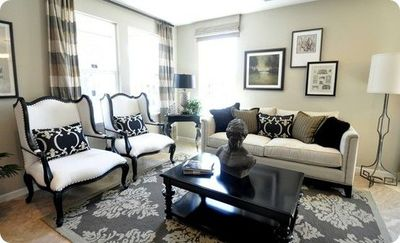 black and tan living room. working with black  tan and white for the living room For