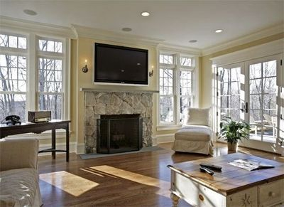 tv mounted over fireplace with sconces / For the home - Juxtapost