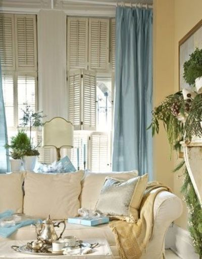 Yellow walls blue curtains living room juxtapost for Living room ideas blue curtains