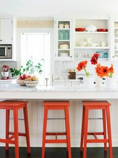 Fun white kitchen pops of orange and turquoise kitchen for Bright kitchen decorating ideas