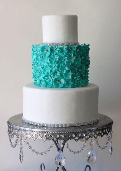 white and turquoise with flowers.