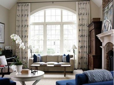Living Room With Large Arched Window By Design Atlier