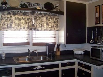 White Kitchen Cabinets With Black Doors white cabinets with black doors / For my kitchen   Juxtapost