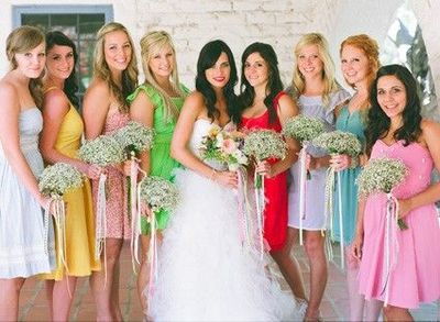 """""""Or maybe this? I do love color!"""" Having all the bridesmaids wearing different colors and different style dresses is very cute."""