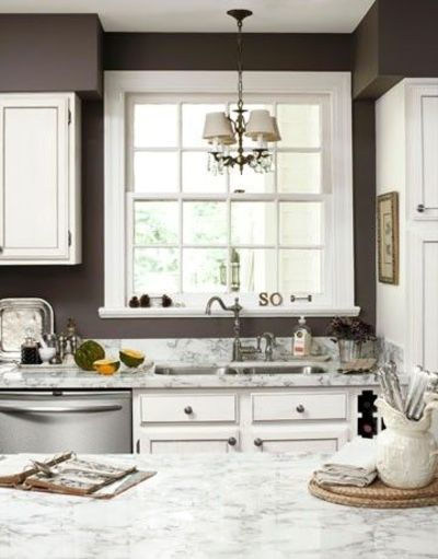 dark brown walls white cabinets light and airy for