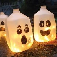Milk jug ghosts with christmas lights.