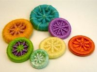 These yarn-based buttons look cute.