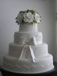 Gorgeous white wedding cake with sugar roses