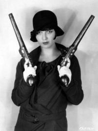 louise brooks with horse pistols.