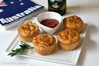 Mini Meat Pies: Mini Meat Pies - an iconic Australian dish made with shortcrust and puff pastries and filled with be...[read more at Food Frenzy]