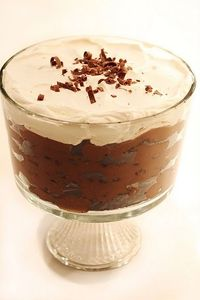 Creamy Oreo Trifle 2  16.6 oz packages Oreo cookies, coarsely crushed 2  5.9 oz boxes Jello chocolate pudding, mixed with  5 1/2 - 6 cups whole milk 1 pint heavy whipping cream whipped with 3 tablespoons sugar In an 8 or 9 in ro...