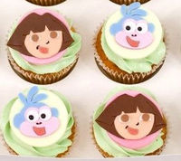 cupcakes inspired by Dora the Explorer and boots