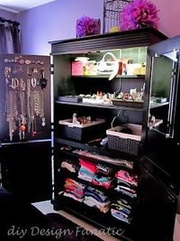 converting an old entertainment center in to a wardrobe... So doing this!!!