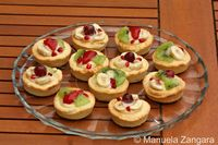 Fruit Tartelettes: Fruit Tartelettes - delicious pastries filled with crème patissière and decorated with fresh slice...[read more at Food Frenzy]