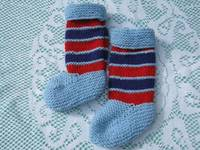 Beautiful Baby Blue Hand Knitted with a touch of Red Socks for a Baby Boy. from etsy.com