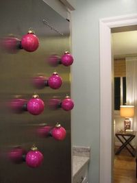 glue magnets to ornaments to decorate your fridge