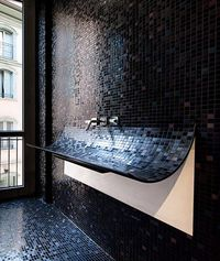 Oh how cool - a curved, mosaic tile, bathroom sink, called Skin.