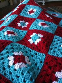 INSPIRATION: Red, white and turquoise granny square afghan.