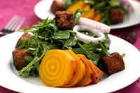 Roasted Yellow Beet salad with Tempeh croutons and warm Maple-Mustard dressing
