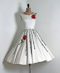 I almost feel the need to add a red rose to my dress...