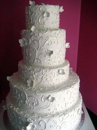Scroll Wedding Cake with White Flowers
