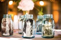 Mason jars with pictures in it, also for wedding receptions table centerpiece