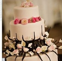 great cake for receptions with branch an pink flower centerpieces