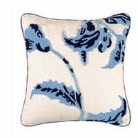 Blue on white floral hooked throw pillow.