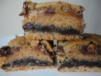 Motherload Cookie Bars: The Mother of all cookie bars. There is a sugar cookie layer, a double chocolate layer, a peanut bu...[read more at Food Frenzy]