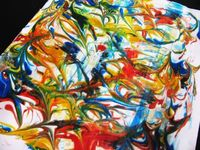 Shaving cream and food coloring paper marbleing.