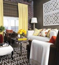 yellow curtains with the rug and the lattice artwork over the couch