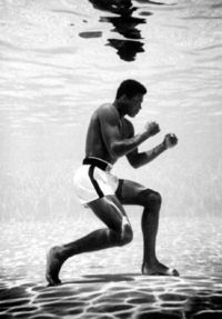 Muhammad Ali boxing under water.