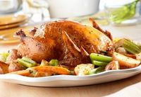 This is no ordinary roast chicken! A flavorful combination of chicken stock and orange juice enhance the flavor of herbed chicken and colorful vegetables to create thisenjoyable one-dish supper.