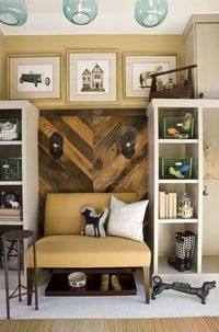 wood walls in a chevron pattern. like the little reading nook too