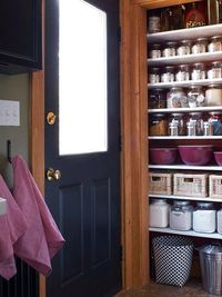 Careful planning makes this pantry a storage success. Jars and baskets were purchased to fit the shelves. Packages of dry goods can be transferred to air-tight jars, which all line up perfectly along the shelves, eliminating the challenge of trying to con...