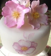 sugar flowers and painted flowers on side..