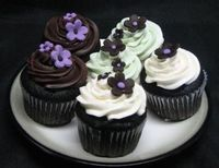 i like the purple flowers on the dark frosting - it jumps out, very pretty