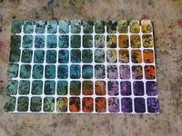 stamp a page of mini address labels, spray wash with color--instant art!