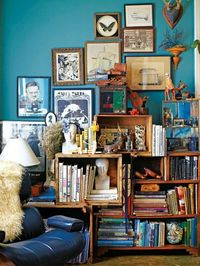 love the art, and crates that work as bookshelves.