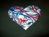 Marbled paper using shaving cream. It's a sensory activity and art project all in one. I love it!