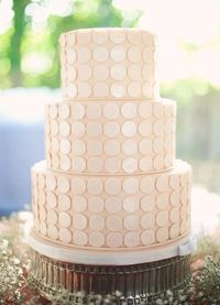 pale pink wedding cake with button detail