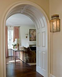 Curved, paneled arch