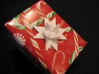 Paper star ornament tutorial. To use as a gift bow (or hair bow?)